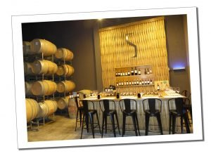 The scene its set, Wine barrels & empty glasses, ready for tasting session. Bodega Ruca Malen, Mendoza, Argentina
