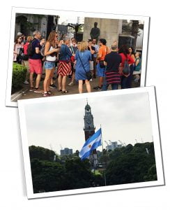 The Argentinian flag flies high over a park during a walking tour, Buenos Aires, Argentina