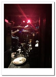The view from backstage of the band playing at a Chicago blues club