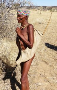 An elderly San Bushman with a bow and arrow, Namibia