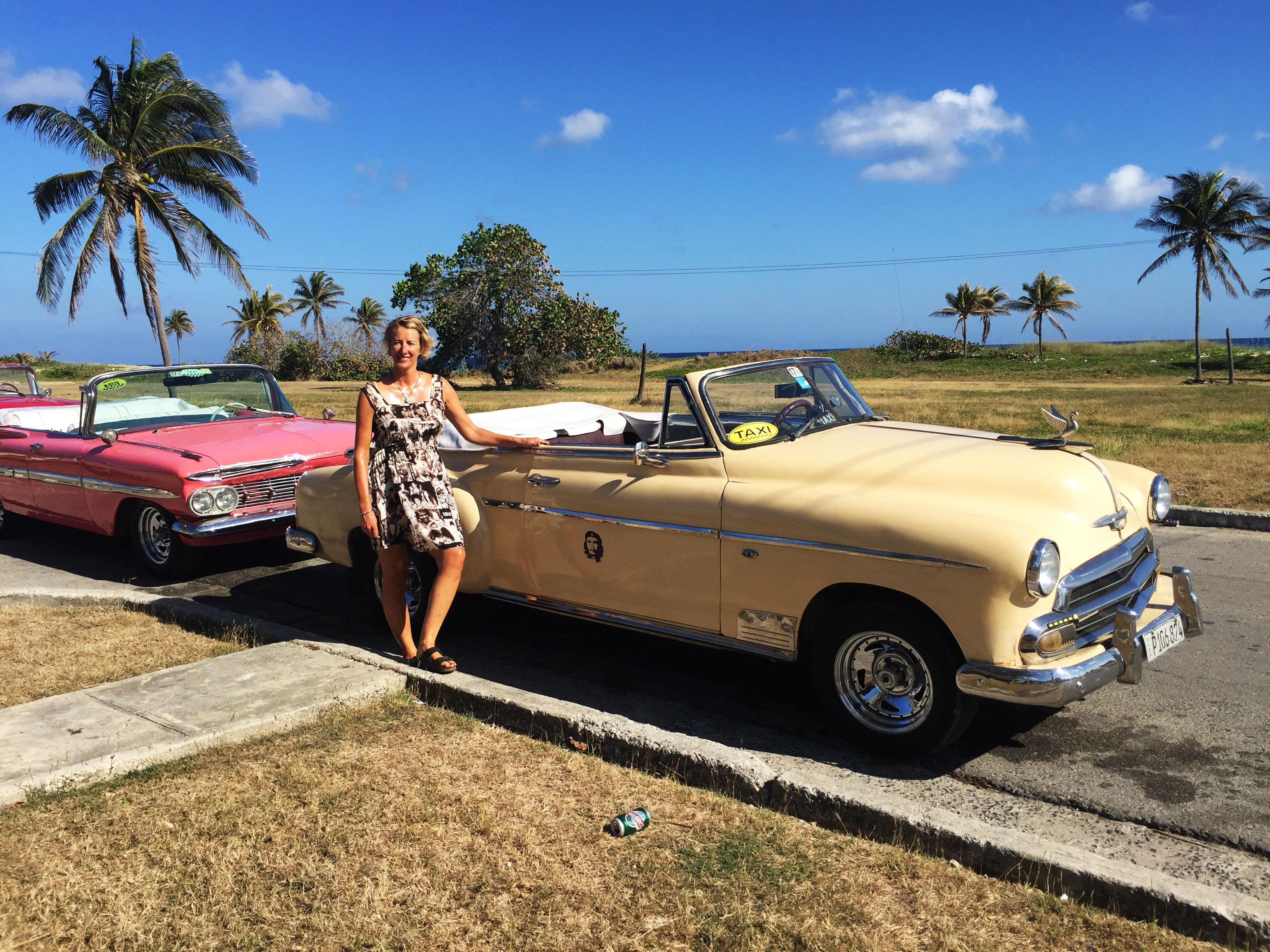 SueWhereWhyWhat & a Classic yellow Cuban convertible taxi Havana, Cuba