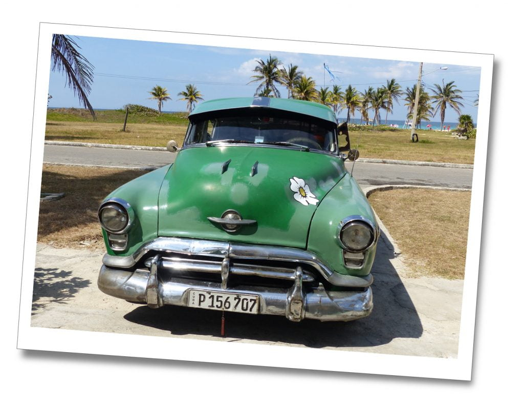 Classic Green Cuban Car, parked & emblazoned with a large white daisy on it's bonnet, Tarara, Cuba