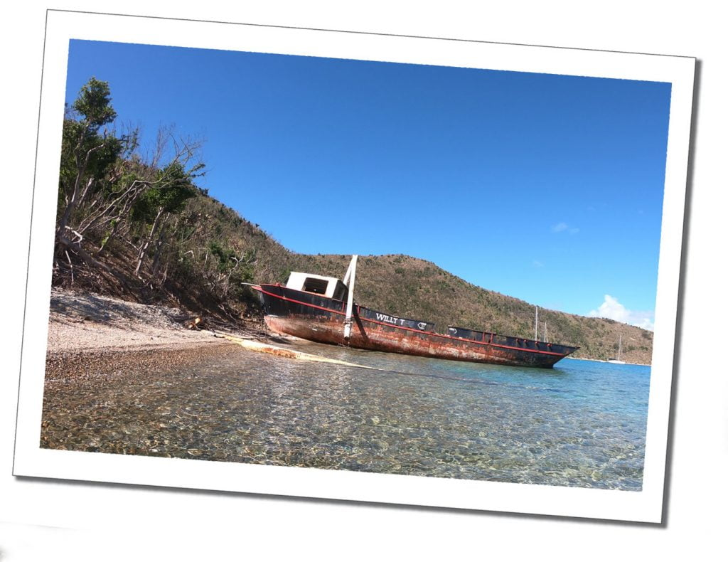 The rusting hull of a boat named Willy T, lays washed up on the beach at Freetown, Grand Bahama, 6 Top Tips on Visiting An Area After a Hurricane