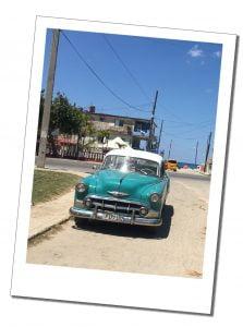 A Classic Green Car Cuban Car, basks in the sunshine, Havana, Cuba