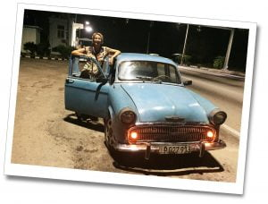 SueWhereWhyWhat & a blue Cuban car at night