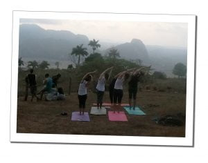 SueWhereWhyWhat & group practise mountain top Yoga at sunrise in Viñales, Cuba