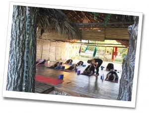 A class demonstrating Yoga, at retreat insider, Viñales, Cuba