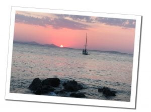 A lone ship in a pink sunset, Naxos, Greece
