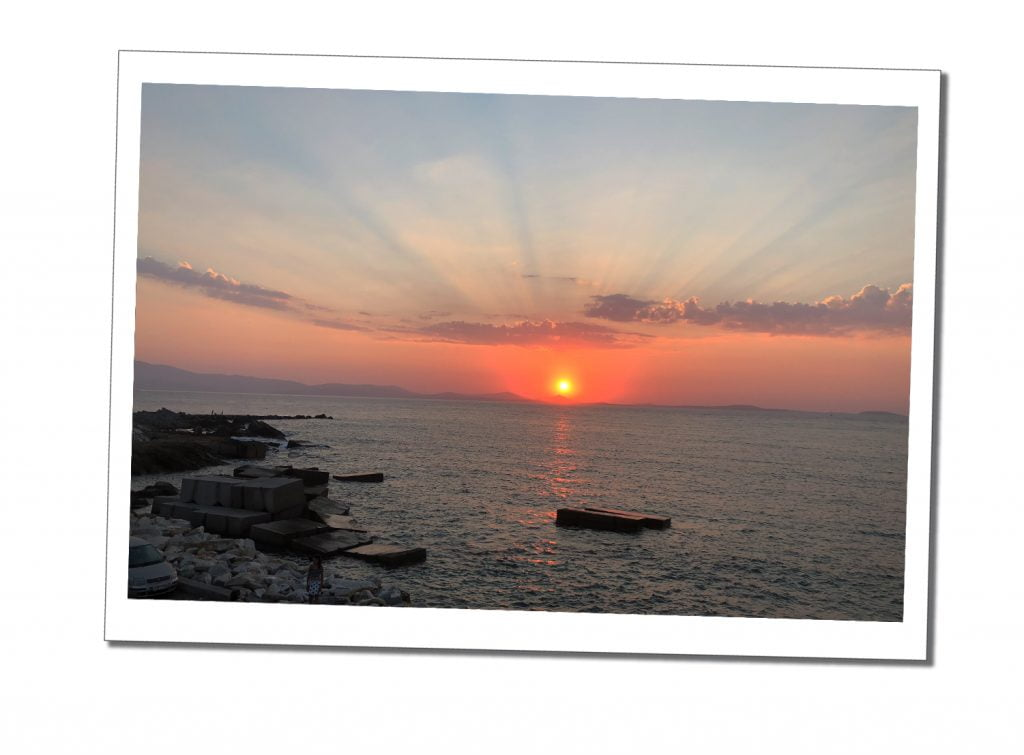 Beautiful orange sunset & rays across a darkening calm, blue grey sea, Naxos, Sunset, Greece
