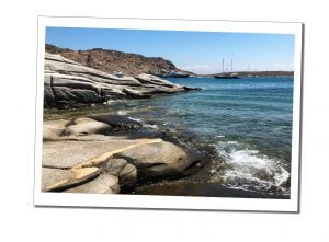 Smooth rocks laps by gentle seas on a beautiful sunny day Monastiri, Beach, Paros