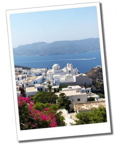 White buildings overlook the stunning bay at Kastro, watching the Plaka to Milos Ferry