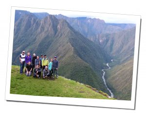 A stunning view and a group shot of the Hikers with SueWhereWhyWhat, above the valley, Inca Trail, Peru