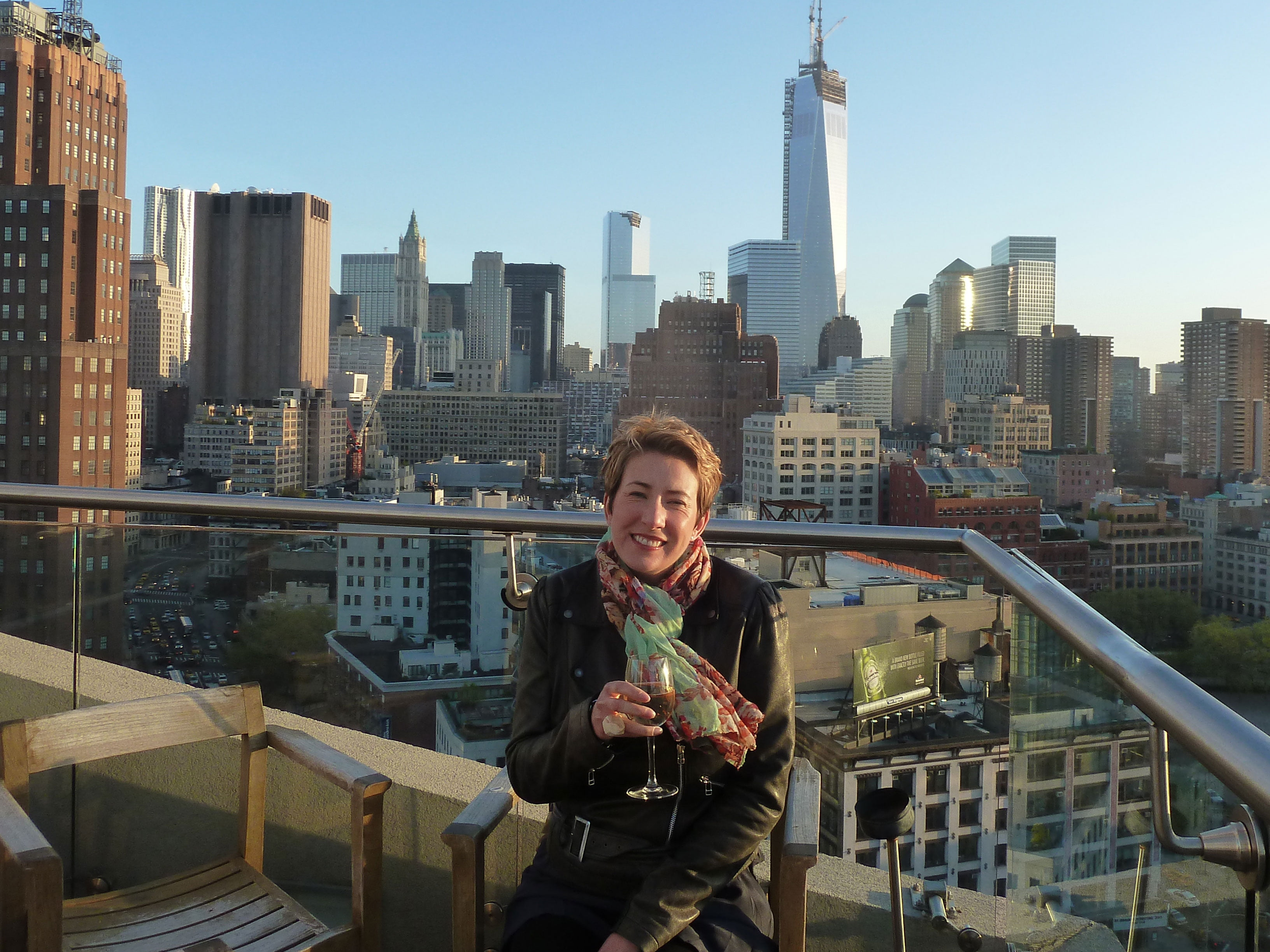 Suewherewhywhat drinking wine on New York rooftop.
