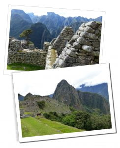Walls of Inca buildings at Machu Picchu & spectacular mountain range in distance