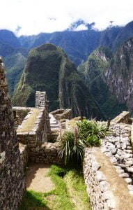 Outer walls of Inca buildings looking to the mountains, Machu Picchu