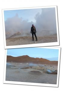 SueWhereWhyWhat stands in the steam in a wooly hat at the Sol De Manana Geyser in Bolivia