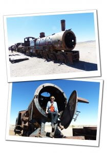 SueWhereWhyWhat sits in a rusty Train at the train Cemetary, Salar de Uyuni (Salt Flats) Bolivia