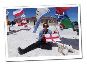 SueWhereWhyWhat at Uyuni holding the flag of St.George, Bolivia Salt Flats