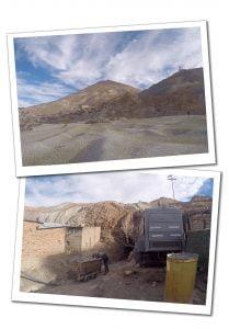Miners push a heavy laden cart from the Mines at Potosi, Cerro Rico, Bolivia
