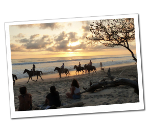 Sunset horse riding on the shore of Santa Teresa Beach, Costa Rica