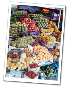 A vast array of fruit on a market stall, including apples, bananas, pears & grapes Sucre, Bolivia