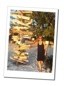SWWW on the beach by big wooden sign post Stocking Island