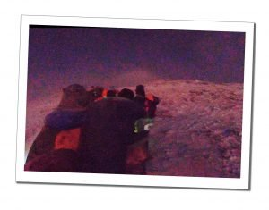 The group taking a rest in half light near the summit, Kilimanjaro