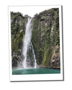 A picture of a cascading waterfall near Milford Sound, New Zealand