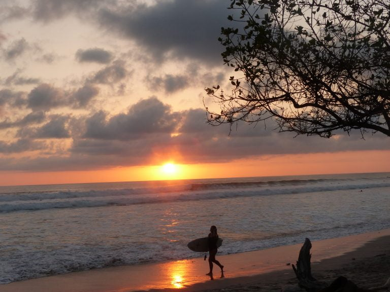 Surfer, Santa Teresa Beach at sunset, Costa Rica