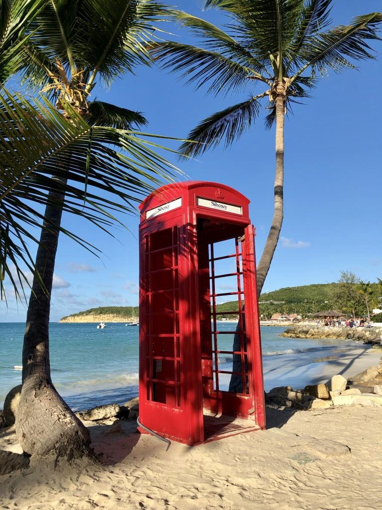 British red telephone box on the beach, Dickenson Bay, Antigua