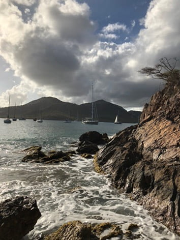Rocky outcrop with distant boats, Antigua