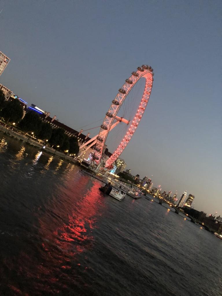 The illuminated London Eye at night, South Bank, London
