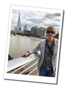 SWWW on The Millennium Bridge over the Thames looking to The Shard, London
