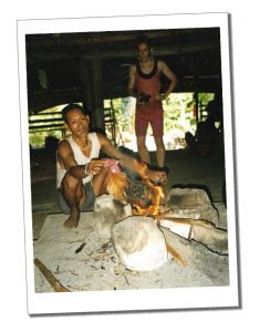 Villager cockerel over fire post sacrifice, Indonesia, Siberut - Crazy Travel Stories