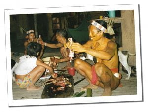 Villagers preparing a meal, Indonesia, Siberut - Crazy Travel Stories