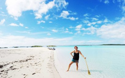 SWWW with a paddle on a deserted beach for her Florida to the Bahamas title image