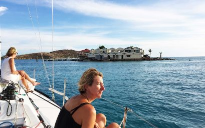 SueWhereWhyWhat on a yacht passes a derelict hotel in the Caribbean. 6 Top Tips on Visiting An Area After a Hurricane