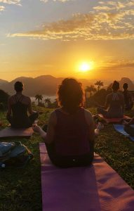 SueWhereWhyWhat is far left as her and her group practise Yoga in Viñales, Cuba